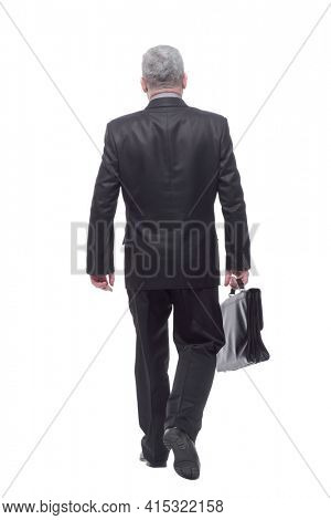 Rear view of businessman walking with briefcase