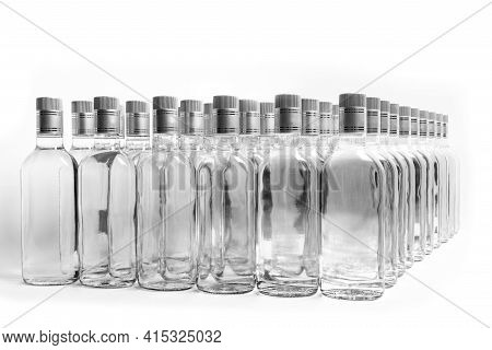 Multitude Of Pure Alcohol Bottles Not Labeled. Bottles Of Home Alcoholic Beverages Isolated On White