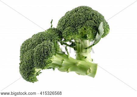 Healthy Green Organic Raw Broccoli Florets Ready For Cooking Isolated On White Background.