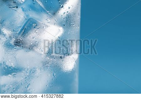 Ice Cubes In A Misted Glass With Drops Of Ice Water Close-up Macro. Soft Selective Focus