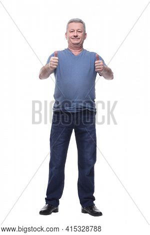 Smiling middle aged man standing with his hands in pockets