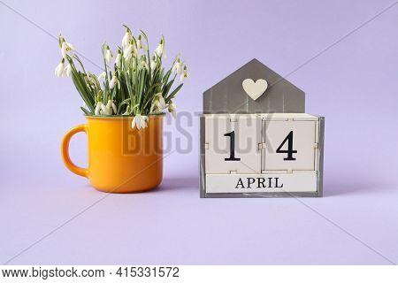 Calendar For April 14: Cubes With The Number 14, The Name Of The Month Of April In English, A Bouque