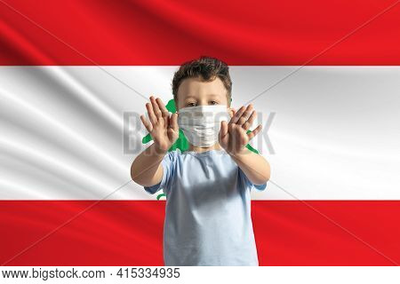Little White Boy In A Protective Mask On The Background Of The Flag Of Lebanon. Makes A Stop Sign Wi