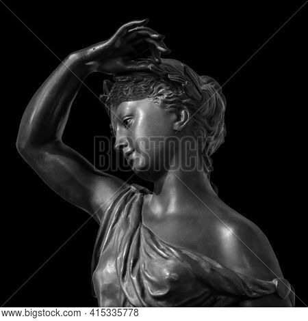 Ancient white marble sculpture head of young woman. Statue of sensual renaissance art era woman antique style. Isolated on black background.
