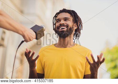 Photo Portrait Of Guy With Dreadlocks Smiling Talking To Reporter Taking Part In Public Asking Speak
