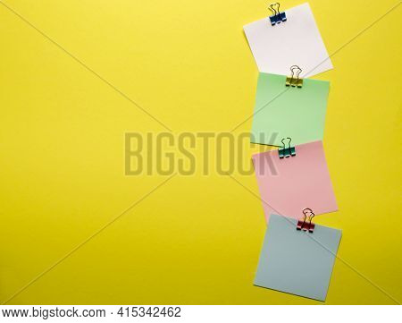 Clips With A Paper Card Template On A Yellow Background For Text Or Image. Paper Layout. Promotions