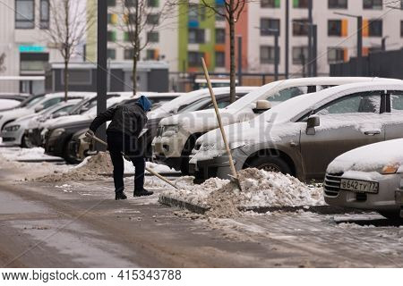 Moscow. Russia. Winter 2021. Janitor Cleans Snow In Moscow. Tajik Janitor With A Shovel In Winter.