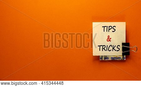 Tips And Tricks Symbol. White Paper Clip With Dollars Cash Money. Words 'tips And Tricks'. Beautiful