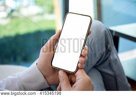 Man In Jeans Holding Hands Gold Phone With Isolated Screen In Office