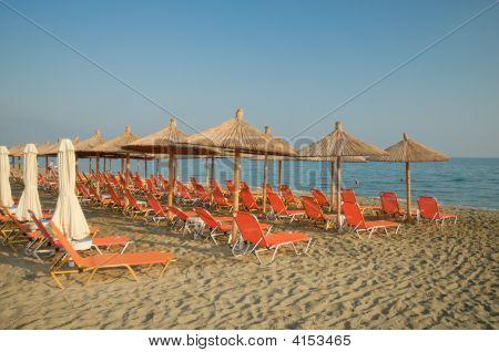 Deck Chairs And Beach Umbrellas