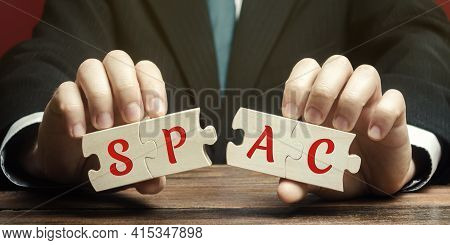 Wooden Puzzless With The Word Spac - Special Purpose Acquisition Company. Simplified Listing Of Comp