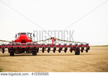 Large Modern Tractor For Preparing The Field After Winter For Sowing Grain. Agricultural Machinery