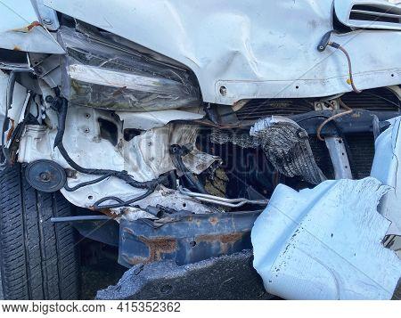 Van Front Damaged Due To Accident - Automotive Insurance Coverage, Repair, Garage Concept