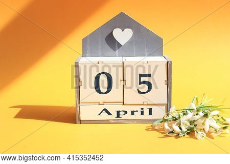 Calendar For April 5: Cubes With The Numbers 0 And 5, The Name Of The Month Of April In English, A B