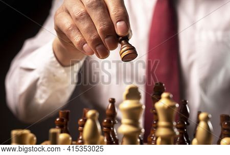 Business Financial Strategy Concept. Businessman Making Decision And Moving Chess Piece Over Other C