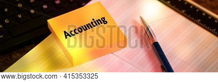 Text Accounting. Note On Orange Sticker Lying On Notepad Next To A Fountain Pen