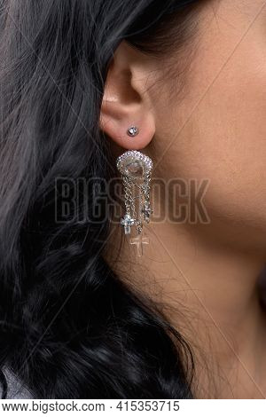 Womens Earring On The Ear. Bijouterie Is Wedding. The Image For The Bride.