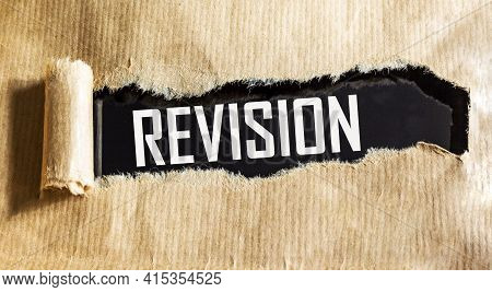 The Text Of The Revision Is Written On A Torn Sheet Of Paper On A Black Background. A Business Conce