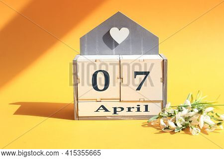 Calendar For April 7: Cubes With The Numbers 0 And 7, The Name Of The Month Of April In English, A B