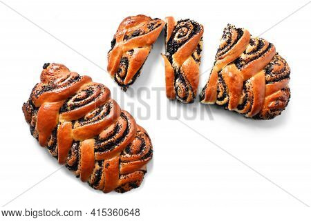 Sliced Roll With Poppy Seeds, Baked At Home On A White Background Close Up. Homemade Cakes. Bread Te