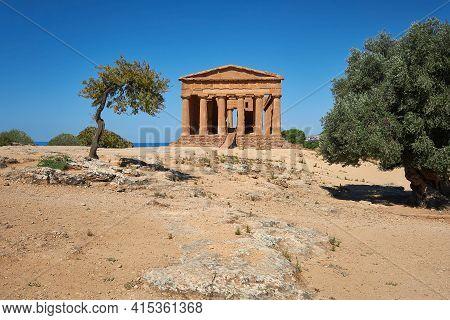 Temple Of Concordia, Or Tempio Della Concordia In Italian. Temple Building With Olive Trees. Valley
