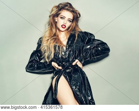 Young Sexy Fashion Woman With Bright Glamour Makeup On Pretty Face In Black Leather Coat On Grey Bac