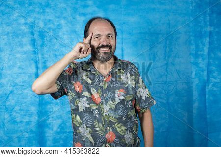 Person Dressed As A Tourist With A Printed Shirt And Expressions On His Face