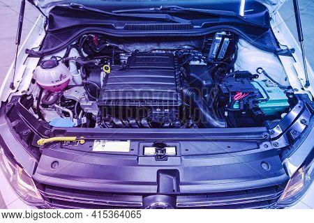 Novosibirsk, Russia - April 01 2021: Volkswagen Polo,closeup Of A Clean Motor Block   Under Pink Neo