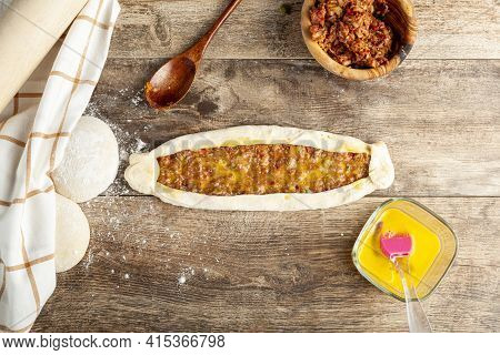 Flat Lay Image Showing Ready To Bake Kiymali Pide, A Sort Of Turkish Pizza Or Flat Bread With Ground