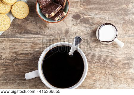 A Tea Time Or Coffee Time Concept With Sandwich Cookies, Bars Of Chocolate Aesthetic Ceramic Mug And