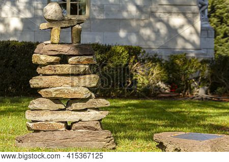 Stack Of Irregular Shaped Stones With A Pi Number Figure On Top. An Abstract Image That May Refer To