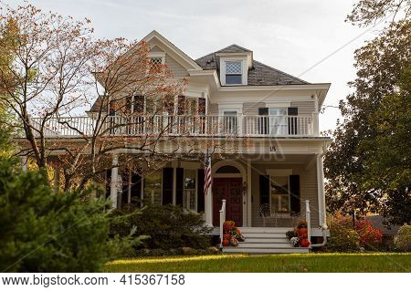 Rockville, Md, Usa 11-01-2020: A Two Story Wooden Colonial Era Historic House In A Well Maintained G