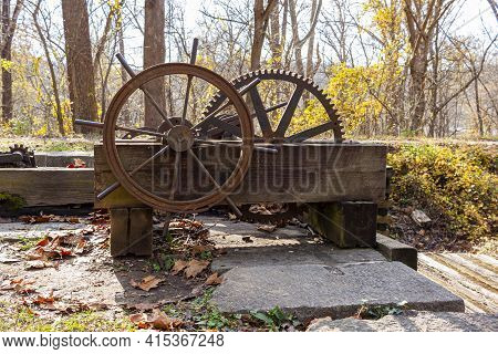 The Rusty Historic Lock System Consisting Of A Hand Operated Group Of Cogwheels Used To Pump Water I
