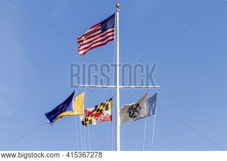 Silverspring, Md, Usa 11-14-2020: A Nautical T Shaped Flag Pole With The Us Flag On Top And Governme
