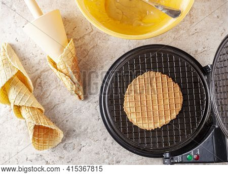 Flat Lay Image Of Non Stick Waffle Cone Maker To Make Homemade Ice Cream Cones. Fresh Made Hand Roll