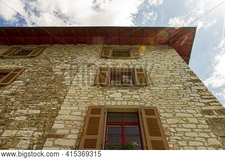 An Old Stone Swiss House Built In 18th Century. Stone Bricks Have Been Partially Replaced Through Re