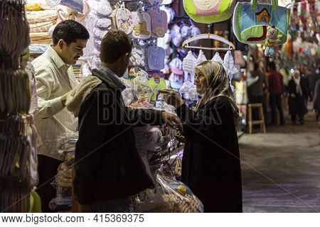 Damascus, Syria 03-28-2010: An Arabic Woman Wearing Hijab Is Shopping At An Apparel And Baby Clothin