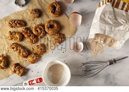 Flat Lay Image Of Handmade Pastry Made With Wholewheat Flour, Egg And Decorated With Sesame And Popp