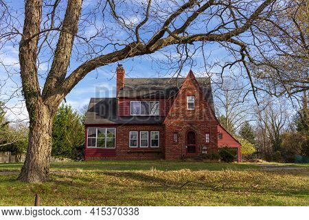 Rockville, Md, Usa 11-10-2020: A Two Story Red Brick Vintage  House In A Spacious Land With A Tall T