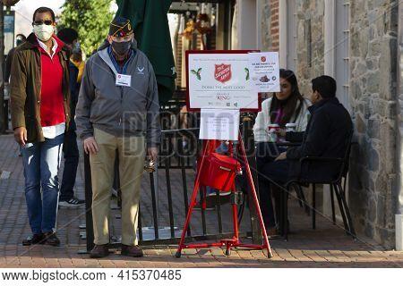 Alexandria, Va, Usa 11-28-2020: An Elderly Veteran With An Airman Side Cap Hat Is Standing Next To A