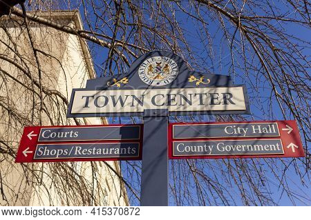 Close Up, Isolated Image Of A Sign Post Located In The Town Center Of Rockville, Maryland Showing Di