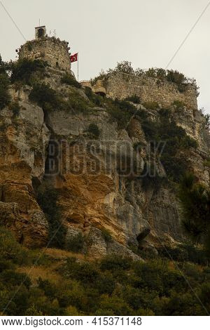 Image Of The Iconic Castle Of Gozne On Top Of Steep Cliffs. The Castle Is Located On Top Of Taurus M