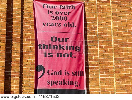 Frederick, Md, Usa 10/13/2020: A Banner On The Exterior Wall Of United Church Of Christ Gives A Mode
