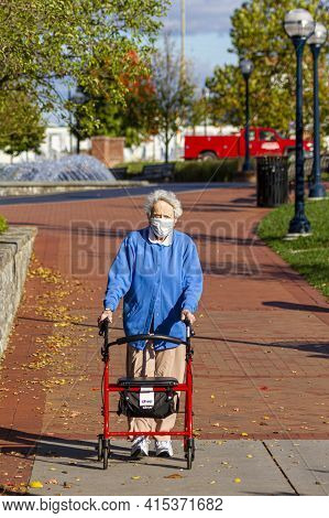 Frederick, Md, Usa 10/14/2020: A Very Old Caucasian Woman Is Strolling In A Park Using Her Rollator