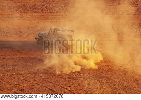 Wadi Rum, Jordan 03/31/2010: An Offroad Vehicle Used For Desert Safari Is Speeding Up In Desert With
