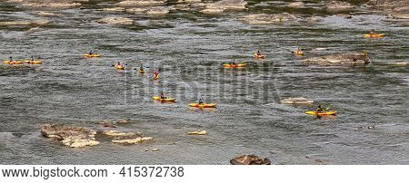 Knoxville, Md, 09/27/2020: A Group Of Kayakers Are Kayaking In Potomac River Together. They All Have