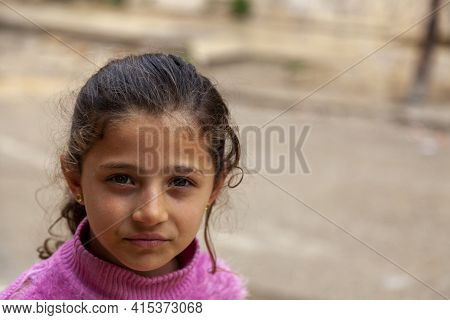 Tartus, Syria 03/27/2010: A Close Up Face Portrait Of An 8 Years Old Brunette Syrian Girl At A Poor