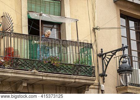 Barcelona, Spain 05/01/2010: An Elderly Caucasian Lady With Gray Hair Is Standing In The Tiny Balcon