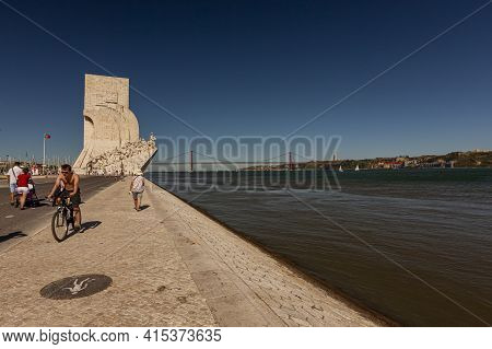 Lisbon, Portugal 07/12/2010: Wide Angle Image Of  The Banks Of Tagus River Featuring,  The Famous Mo