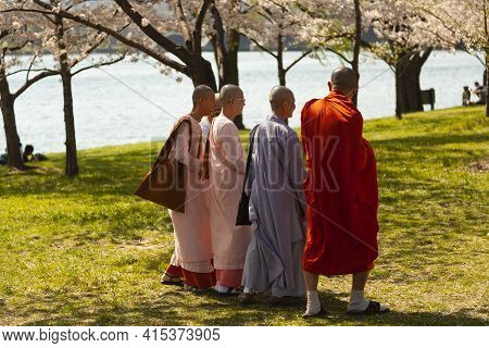 Washington, Dc, Usa 04/10/2013: A Group Of Buddhist Monks Wearing Religious Robes  Are Walking In Th